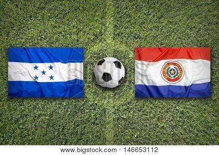 Honduras Vs. Paraguay Flags On Soccer Field, 3D Illustration
