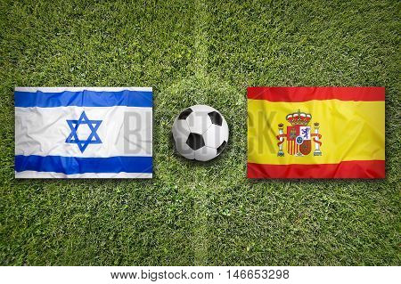 Israel Vs. Spain Flags On Soccer Field, 3D Illustration