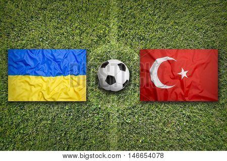 Ukraine Vs. Turkey Flags On Soccer Field, 3D Illustration