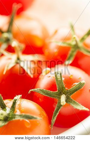 Brightly lit cherry tomatoes. A close up image of ripe cherry tomatoes in bright light.