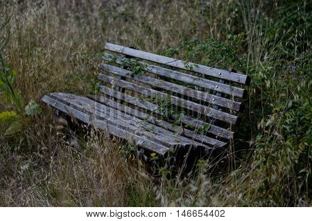A bench seems abandoned in nature near Ioannina, Greece.