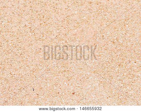uneven mottled surface of matte cream of fine granite gravel