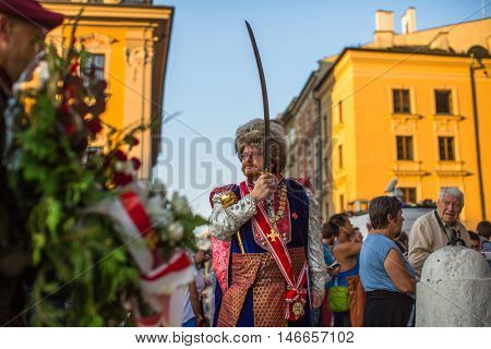 KRAKOW, POLAND - FEB 10, 2016: Polish military in historical costumes during ceremony is the vow of first classes of the Jan III Sobieski High School at the Main Market Square near St.Mary Cathedral.