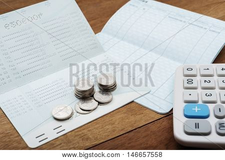 Save money concept, Stack of coins with account bank or bank book save money and save life