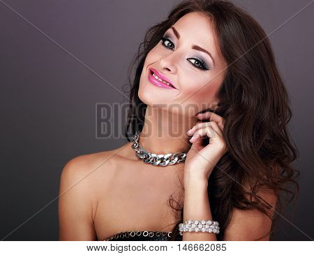 Beautiful Bright Evening Makeup Woman With Long Curly Hairstyle Looking Happy In Pearl Bangle And Fa