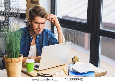 I don't understand it, man sittining in front of laptop