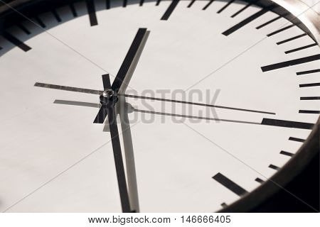 Clock with moving hands on white dial. Life time running