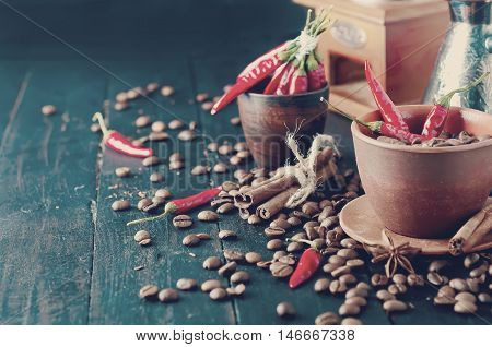 Coffee Beans And Red Chilly Peppers. Tonned Photo