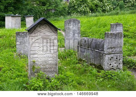 POLAND, KRAKOW - MAY 27, 2016: Old Jewish cemetery beside the Remuh Synagogue in the Kazimierz Jewish district of Krakow. Poland.