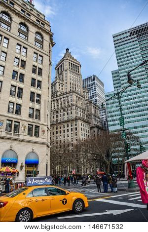 NEW YORK, USA - DECEMBER 28, 2015: Street view, buildings and life around Battery Park.