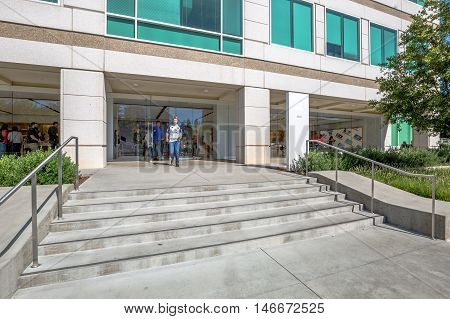 Cupertino, CA, USA - August 15, 2016: people come from the popular Apple store of Apple Inc Headquarters at One Infinite Loop located in Cupertino, Silicon Valley, California.