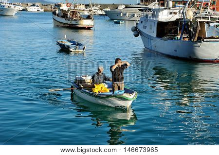 Santa Margherita, Italy - March 27, 2015: Fishermans with a catch in port Santa Margherita, Ligure, Italy