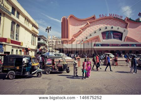 JAIPUR, INDIA - FEB 6, 2015: People going to a famous movie theater Raj Mandir opened in 1976 in Pink City on February 6, 2015. Jaipur with population 6664000 people is a capital of Rajasthan