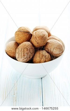 Walnuts on a blue wooden table, close up