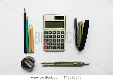 Office supplies studying tools calculator, stapler, pencil sharpener, pencils and divider isolated on white background