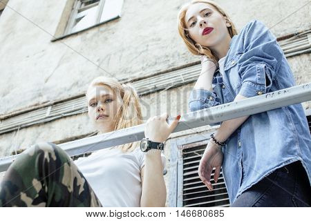 two blonde real teenage girl hanging out at summer together best friends, lifestyle people concept close up