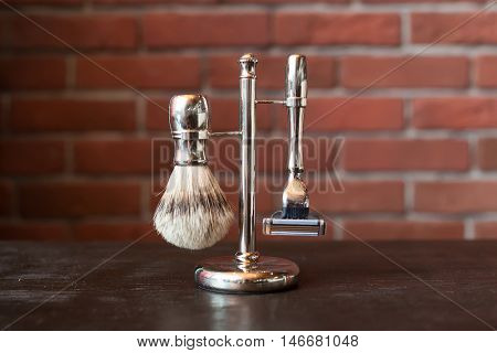 Machine for shaving and brush on the stand