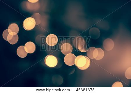 Blue toned blurred chrismas background  with street lights on the night street in vintage style