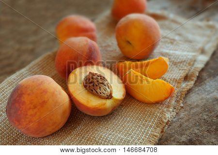 Fresh peaches on a sackcloth