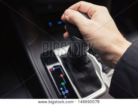 Driver Hand On Gear Lever Of Luxury Car