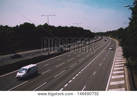 Beaconsfield, England - June 2016: Busy M40 Motorway At The Beaconsfield Turn Off  Vintage Retro Fil