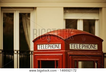 Red telephone booth and mail box in street in London as the famous icons.