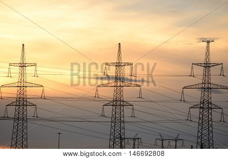 Electric power transmission lines at sunset outskirts of St. Petersburg Russia.
