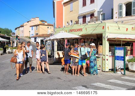 Port Grimaud, Provence, France - August 23 2016: Holiday Makers Queue For Ice Cream While On Vacatio