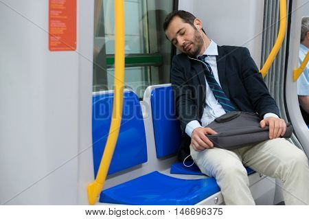 Tired Businessman Sleeping On The Underground Metro
