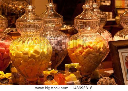 BELGIUM, BRUSSELS - SEPTEMBER 06, 2014: Decorated shop window sells traditional Belgian sweets and chocolate in Brussels.