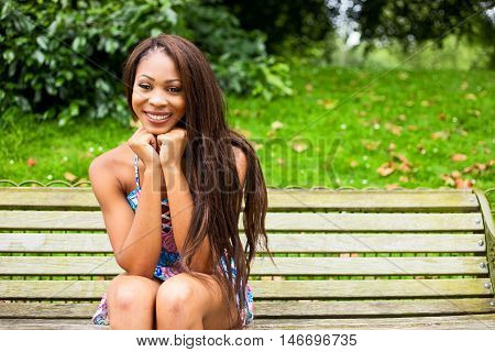 a beautiful young woman in the park