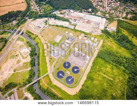 Aerial view to biogas plant from sewage treatment in green fields. Renewable energy from biomass. Waste management for 165, 000 inhabitants of Pilsen city in Czech Republic, Europe.