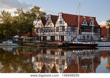 POLAND, GDANSK - AUGUST 12, 2012: Boats at berth Motlawa River in the historic center of Gdansk. Gdansk is a popular touristic city on the Baltic coast, the capital of the Pomeranian Voivodeship.