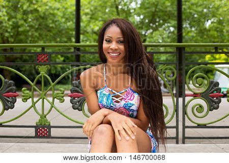young woman sitting relaxed in the park