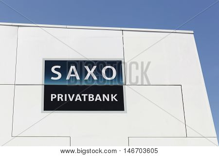 Fredericia, Denmark - September 10, 2016: Saxo Bank logo on a wall. Saxo Bank is a Danish investment bank specializing in online trading and investment