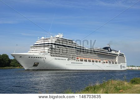 Velsen the Netherlands July 7th 2014 : MSC Magnifica on North Sea Canal from Amsterdam towards the Ijmuiden locks The Magnifica is operated by MSC since 2010 and 293.8 metres (964 ft) long.