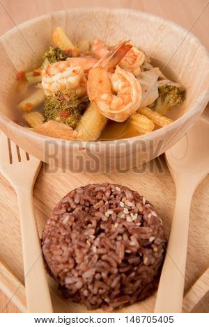 Sour soup with shrimp and mix vegetable healthy food and brown rice low fat