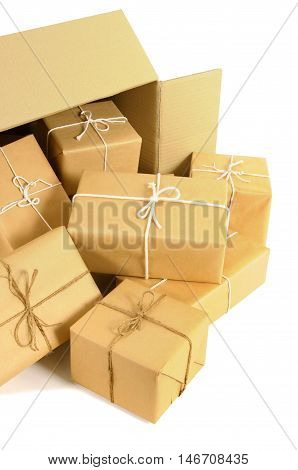 Cardboard shipping box with several brown paper packages inside