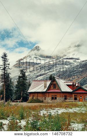 Cabin with snow capped mountain and forest in Banff National Park