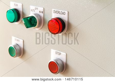 Overload sign buttons on electric control panel.