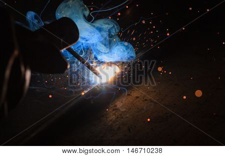 Arc welding and welding fumes in welding steel process.