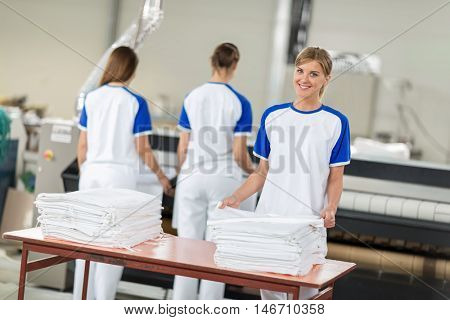 Women employed agree ironing textiles in chemical cleaners