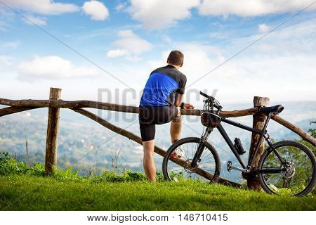 Young cyclists relaxing and looking at the beautiful view in front of you