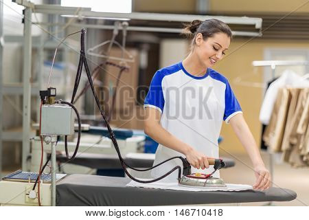 Women iron on ironing board
