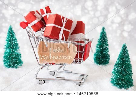 Trollye With Christmas Gifts Or Presents. Snowy Scenery With Snow And Trees. Sparkling Bokeh Effect. Label With German Text Frohe Weihnachten Means Merry Christmas