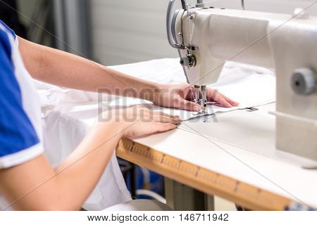 Seamstress sewing with sewing machine