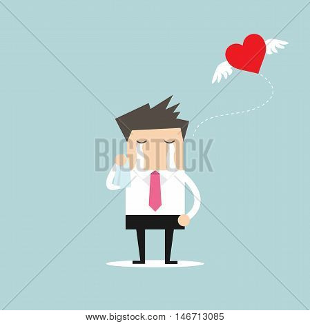 Businessman crying broken heart with heart flying away