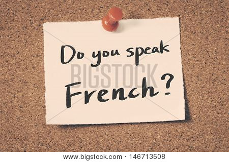 Do you speak French? note pin on the bulletin board