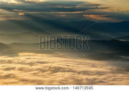 View of a valley in a beautiful early morning with fog between hills at Doi Samer Dao in Si Nan National Park High mountain in Nan province Thailand