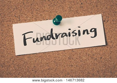 Fundraising note pin on the bulletin board